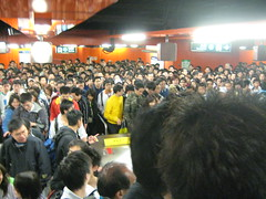 People Waiting to Get on the Escalators