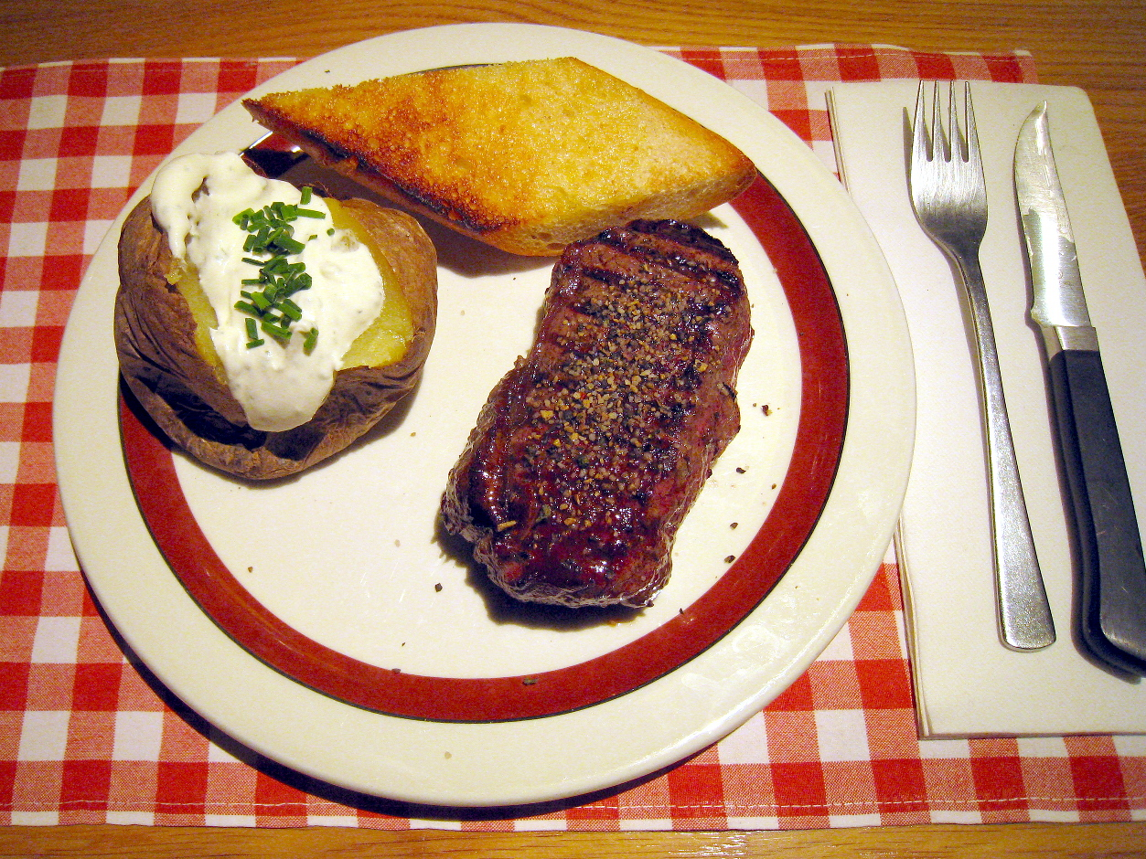 Mr rumpsteak 250g with baked potato and sour cream and garlic bread block house