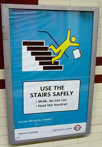 Stick figure falling down stairs - London Underground