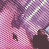 man and reflective pink ceiling by essayu