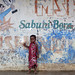 Girl in front of an old painted wall, Tanzania