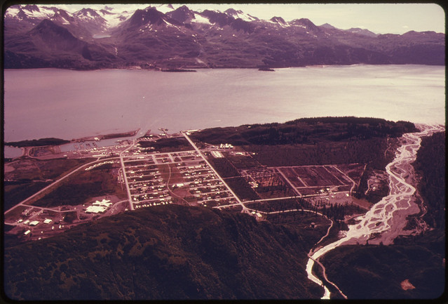 DOCUMERICA: View South Across Port Valdez From New Townsite to Pipeline Terminus and Site of Deepwater Tanker Loading Facilities...08/1974 by Dennis Cowals.