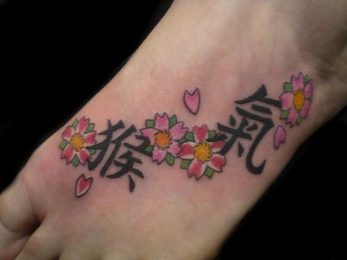 Foot tattoo flower tattoo kanji tattoo