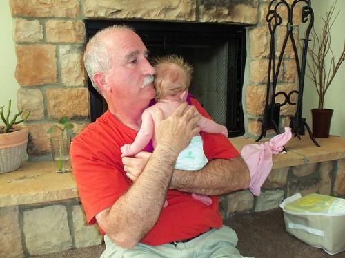 my daddy holding my baby.