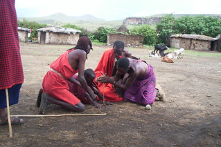 Masai men lighting a fire in Hell's Gate National Park