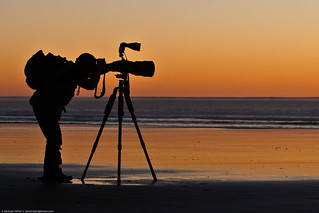 Student shown here in silhouette.  Arthur Morris leads an advanced Instructional Photo Tour class on Morro Strand State Beach 13 Jan. 2009