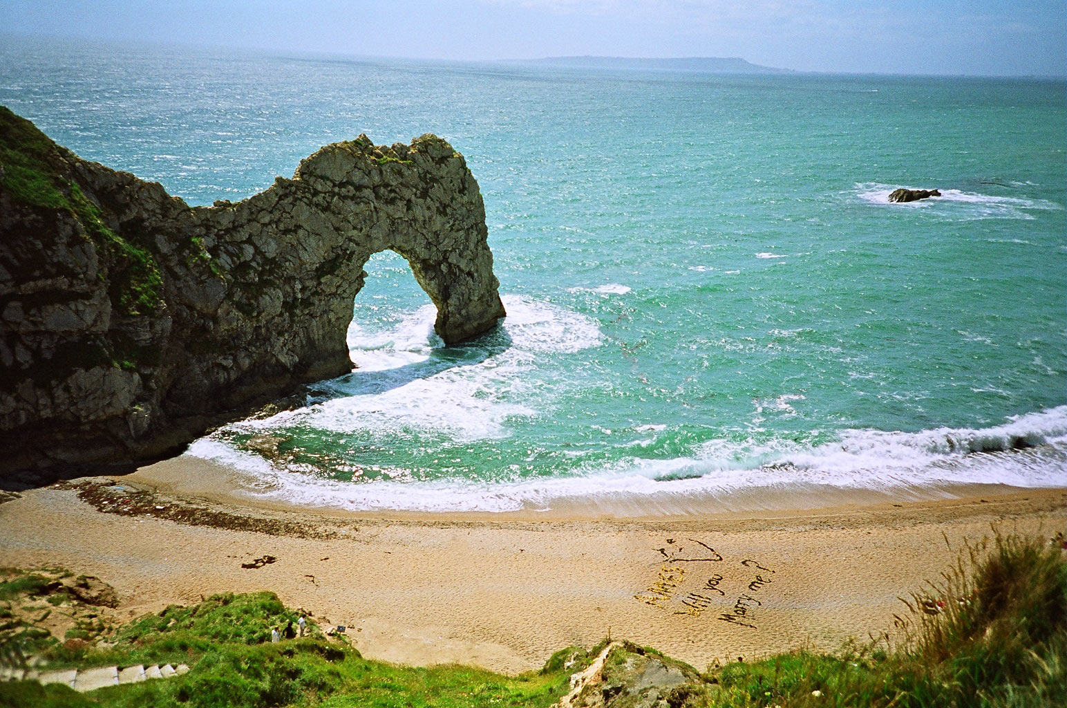 romantic proposal at Durdle Door, Dorset, England