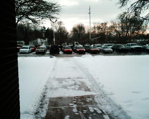 Flatbed in side parking lot