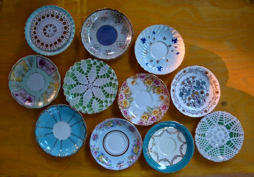 vintage saucers and crocheted covers