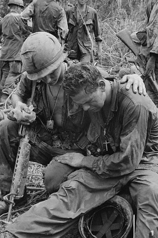 Near Pleiku, South Vietnam, May 26, 1967 - South Vietnam: An unidentified American soldier is comforted by a comrade after breaking down under the strain of combat following a battle about 55 miles west of Pleiku. Troops of the U.S. 4th Infantry Division