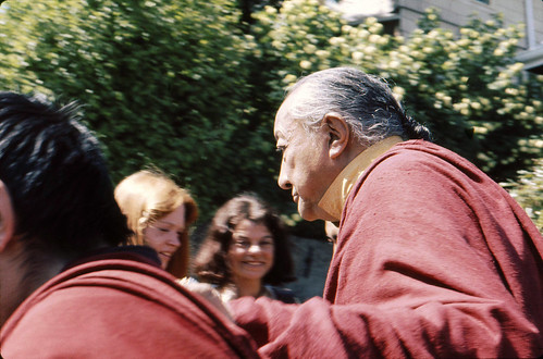 His Holiness Dilgo Khyentse walking, two students in background, Tour of HH Dilgo Khyentse Rinpoche at Sakya Ward St Dharma Center, Seattle Washington USA 1976 by Wonderlane