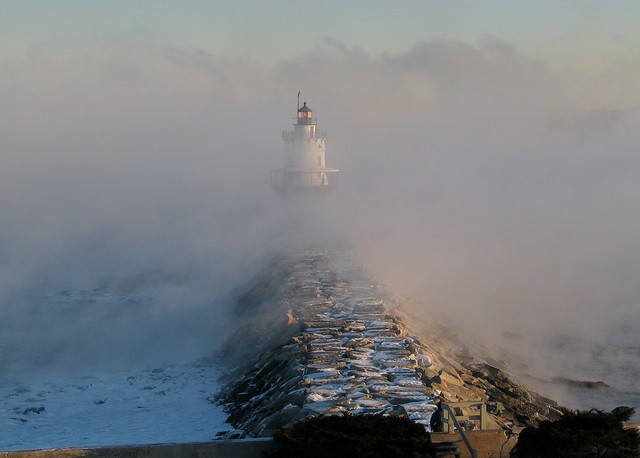 Spring Point Lighthouse surrounded by Arctic sea smoke