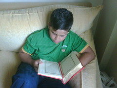 YK reads Quran