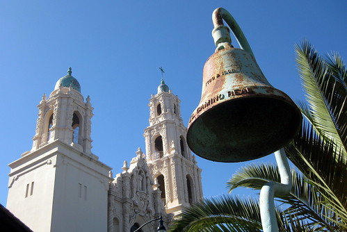 San Francisco - Mission District: El Camino Real Mission Bell and Mission Dolores Basilica