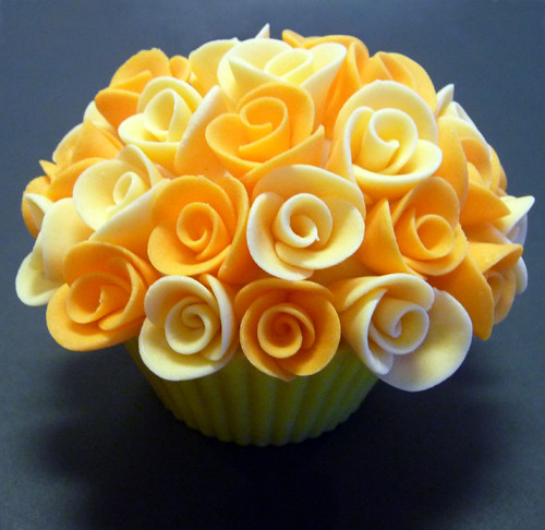 Saffron Cupcake filled with homemade Almond Paste and Vanilla Almond Cream Cheese Frosting