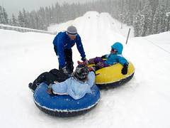 vehicle(0.0), winter sport(1.0), footwear(1.0), winter(1.0), tubing(1.0), recreation(1.0), snow(1.0), outdoor recreation(1.0), sledding(1.0), sled(1.0),