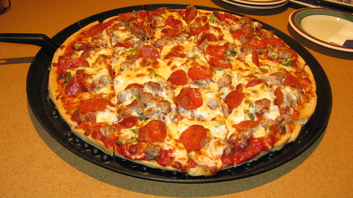 A delicious thin crust Chicago style pizza topped with sausage, Pepperoni, and Green Peppers. by Eddie from Chicago