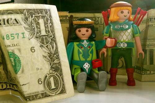 Robin Hood and Marian with their stash of cash