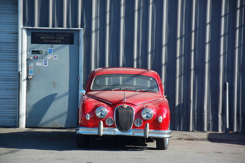 Red Jaguar Mark 1: Parked in front of the garage