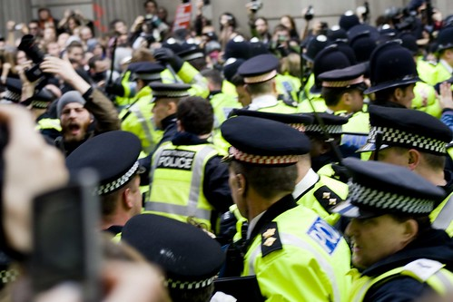 Police charge in with batons flying