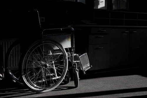Wheelchair partially in the shadow