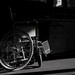 Wheelchair partially in the shadow by Marcel Oosterwijk