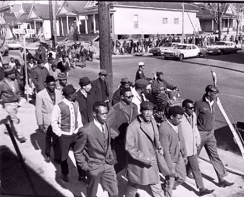 African American sanitation workers and their community supporters march through the streets of Memphis in 1968. by Pan-African News Wire File Photos