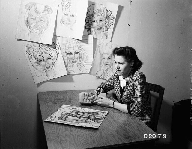 1944 WOMAN WITH ART WORK