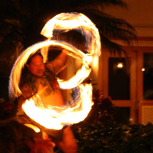A look of concentration as this performer uses fire to awe his luau audience.