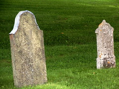 sculpture(0.0), monument(0.0), cemetery(1.0), stele(1.0), stone carving(1.0), headstone(1.0), memorial(1.0), grave(1.0), lawn(1.0),
