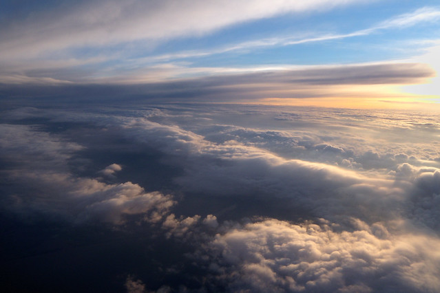 Flying over clouds at sunset flickr photo sharing