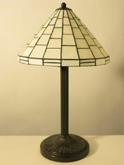 Stained leaded glass lamp shade with Antique brass base.