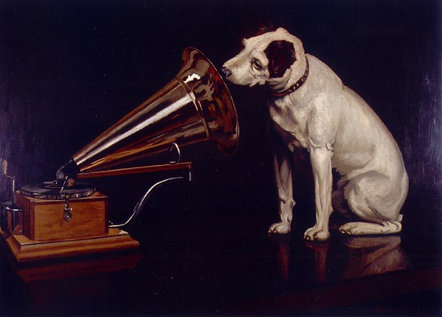 "Dog Looking at and Listening to a Phonograph, ""His Master's Voice"", The Original RCA Music Puppy Dog Logo Symbol for Advertising from Flickr via Wylio"