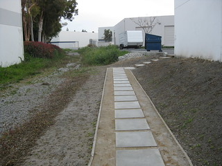 A path of stepping stones between two buildings.