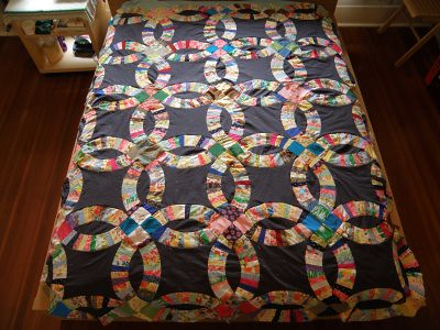 Double wedding ring quilt top - very wrinkled.