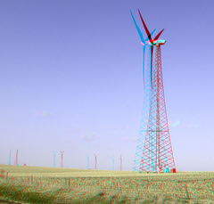 overhead power line(0.0), mill(0.0), transmission tower(0.0), prairie(1.0), machine(1.0), windmill(1.0), field(1.0), plain(1.0), line(1.0), wind(1.0), wind farm(1.0), tower(1.0), wind turbine(1.0),