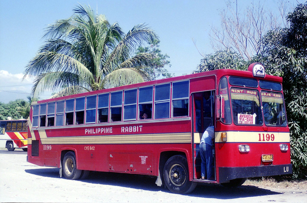 Philippine Rabbit Bus Co Izusu V12 CVE-642 (fleet No 1199) and another bus at a bus and food stop on the highway at Sison, Pangasinan between Tarlac and Baguio, Philippines.