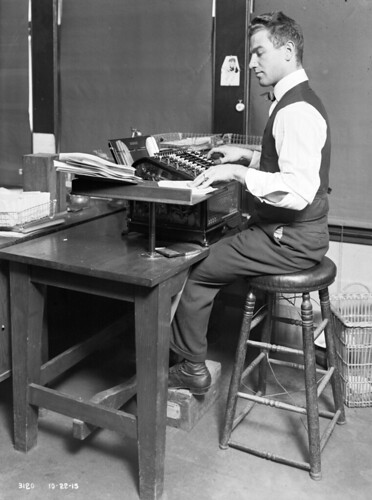 Engineering Department clerical worker at adding machine, 1915