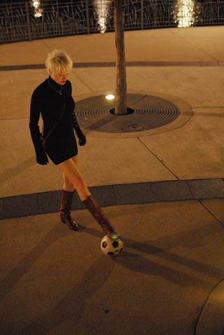 football play in the city at night