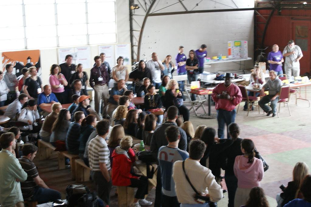 Mac addressing a crowd