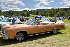 full-size car(0.0), automobile(1.0), automotive exterior(1.0), vehicle(1.0), lincoln continental mark v(1.0), lincoln continental(1.0), antique car(1.0), sedan(1.0), land vehicle(1.0), luxury vehicle(1.0), convertible(1.0), motor vehicle(1.0),