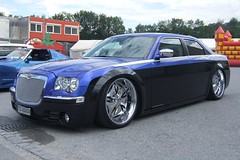 automobile(1.0), automotive exterior(1.0), wheel(1.0), vehicle(1.0), automotive design(1.0), chrysler 300(1.0), chrysler(1.0), bumper(1.0), sedan(1.0), land vehicle(1.0), luxury vehicle(1.0),