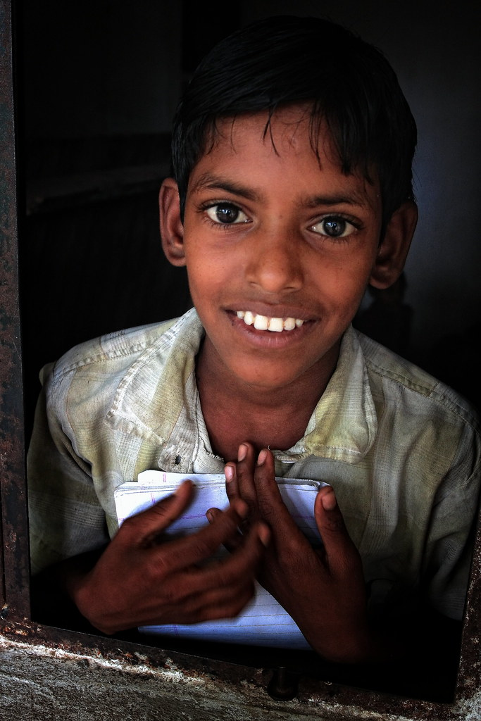 A Student At A Charity School Radiates A Smile