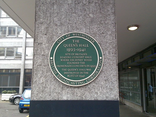 Henry Wood, Queen's Hall, London, and The Promenade Concerts green plaque - The Queen's Hall 1893-1941. Site of Britain's leading concert hall where Sir Henry Wood founded The Promenade Concerts in 1895. The Queen's Hall was destroyed in The Blitz of 1941.