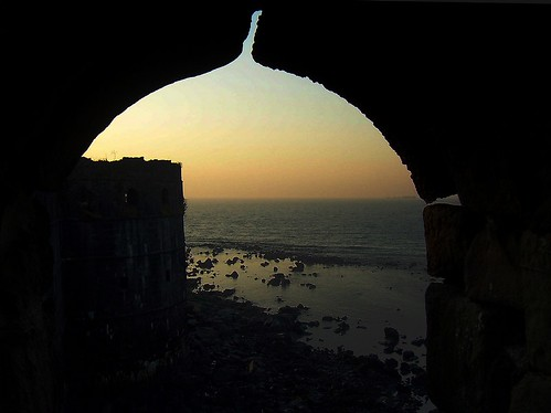 sunset sea beach monument silhouette fort aibagh