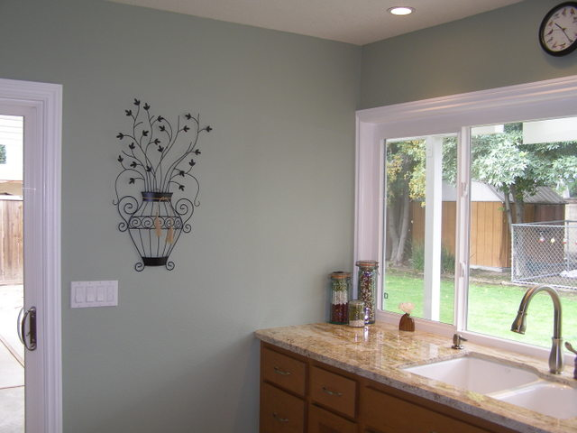 Real homes light green kitchen benjamin moore 39 s for Pale green kitchen paint