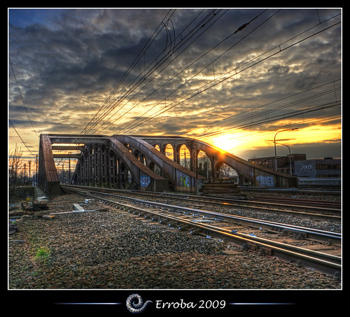 sunset electric clouds photoshop canon rebel grafitti belgium belgique tripod belgië sigma trains wires tips rails joker remote 1020mm erlend hdr mechelen cs3 3xp photomatix tonemapped tonemapping vierendeelbrug spoorwegbrug xti 400d vertorama erroba robaye erlendrobaye