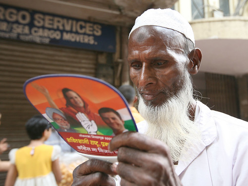 Voter reads an election pamphlet