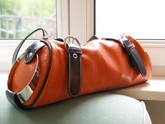 coin purse(0.0), horse tack(0.0), brand(0.0), bag(1.0), orange(1.0), shoulder bag(1.0), brown(1.0), handbag(1.0), leather(1.0), tan(1.0),