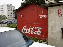 art(0.0), sign(0.0), soft drink(0.0), restaurant(0.0), carbonated soft drinks(0.0), drink(0.0), cola(0.0), coca-cola(0.0), signage(1.0), red(1.0), advertising(1.0),